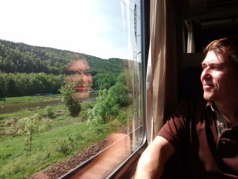 On the way to Praha, Rob, reflecting